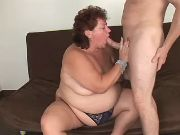 Flabby mature sucking cock of guy