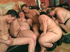 Hot fat chick is the focus of a fuck video taken at a bar orgy with three plumpers