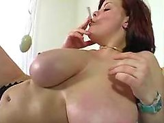 Chesty redhead plump chick enjoys sextoys in bed