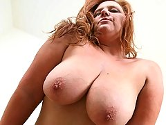 Mature hunk burying his head between BBWs massive tits