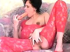 Lonely pregnant lady in red plays with big dildo