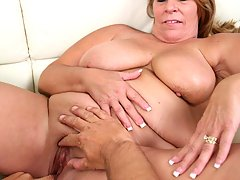 Mature blonde having her plump pussy drilled hard