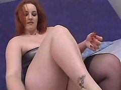 Portly woman blowing dick on couch