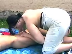 Chubby slut sucks appetizing cock in nature