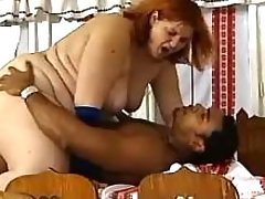 Redhead fatty gets cumload on face