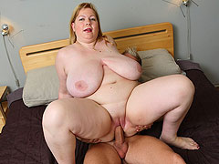 The masseur brings his rock hard cock to her bedroom and he fucks the fatty